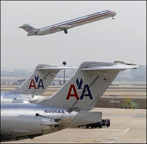 The boards of American Airlines parent AMR Corp. and US Airways have pushed back meetings to consider final plans for their merger, Associated Press sources say. A source close to the matter said Sunday that the AMR board wants to meet in person, and that the US Airways board would only meet after the AMR board approves a deal. The source requested anonymity because the talks are private.