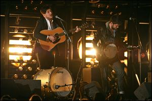 Marcus Mumford, left, and Winston Marshall, of Mumford & Sons perform at the 55th annual Grammy Awards on Sunday in Los Angeles. Mumford & Sons'