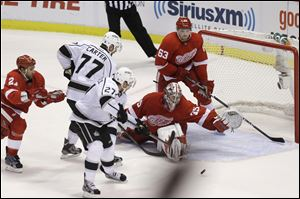Los Angeles Kings defenseman Alec Martinez (27) scores the game-tying goal against Detroit goalie Jimmy Howard, who came up big when the Red Wings needed him most Sunday.