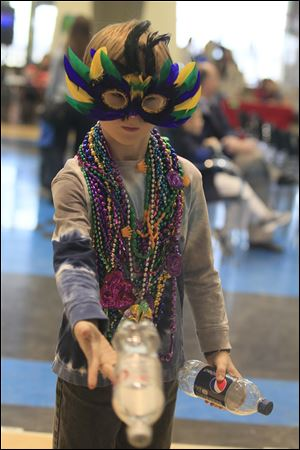 Timmy Horvat, 8, of Perrysburg at the Environmental Club's contest at Mardi Gras. The French Club of Perrysburg Hiigh School hosted a Mardi Gras at the school today. About 300 were expected to attend.