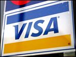 A Visa credit card sign is displayed in a store window in Des Plaines, Illinois, U.S., on Tuesday, Feb. 3, 2008. Visa Inc., the world's largest electronic payments network, will report earnings on Feb. 4. Photographer: Tim Boyle/Bloomberg News