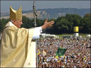 Pope Benedict XVI waves to the crowd at the end of a papal Mass in Regensburg, southern Germany.