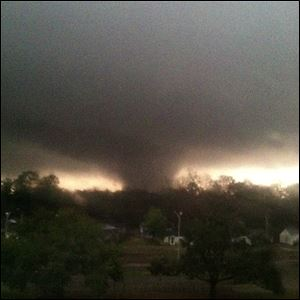This photo provided by Jordan Holliman shows a tornado moving through Hattiesburg, Miss., Sunday.