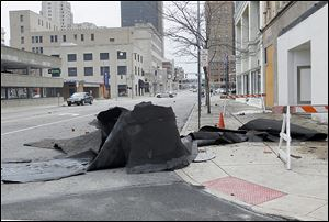 A section of Jefferson Avenue was closed on Monday after parts of the former  Caesar's Show Bar fell onto the street and sidewalk because of wind gusts. Inspectors will try to determine the extent of damage and the structure's integrity before reopening the street.