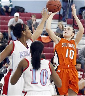 Bailey Hejl, who led Southview with 12 points, shoots over Bowsher's Imani Fifer, left, and Isis Dixson in Monday night's game. The Cougars had 10 players score at least four points.