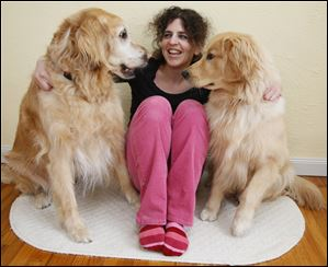 Madalyn Ruggiero is with her golden retrievers, Denali, left, and Sir Wilbur. Denali was diagnosed with nasal cancer last fall.
