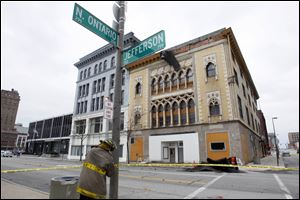 Strong winds caused bricks to fall from this downtown Toledo building, resulting in an intersection being closed.