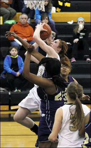 Perrysburg's Sarah Baer shoots over Waite's Latesha Craig. The junior center led the Yellow Jackets with 17 points.