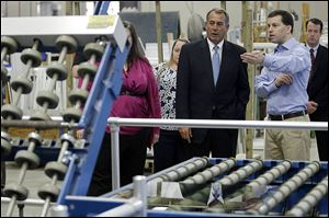 House Speaker John Boehner of Ohio tours Vinylmax LLC with vice president and owner Craig Doerger, right, Monday in Hamilton, Ohio. Vinylmax is a top window producing company.