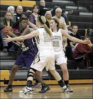 Waite's Janae Kenny is trapped by Perrysburg's Samantha Gremler, left, and Lindy Delong in Monday night's game. The Yellow Jackets turned up the pressure on defense to improve to 19-1 on the season.
