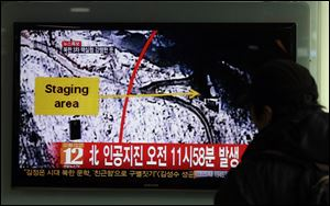 A South Korean passenger watches TV news reporting an earthquake in North Korea after an underground atomic test, at the Seoul train station in Seoul, South Korea, today. The U.S. Geological Survey today detected a magnitude 4.9 earthquake in North Korea.