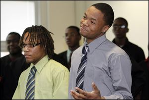 Seniors Bryan Pinkney, left, and Bryson Collins were among the students who defended Scott High School on Tuesday. They raved about the television broadcasting studio at Scott.