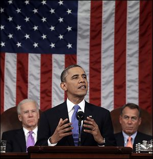President Obama is flanked by Vice President Joe Biden and House Speaker John Boehner during his State of the Union address. In Tuesday's speech, he urged Americans to be the 'authors of the next great chapter in our American story.'