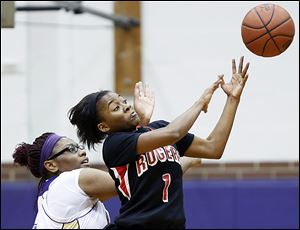 Sasha Dailey steals a pass intended for Waite's Latesha Craig. Dailey averages 12.6 points. Rogers is 17-3, 10-0 in the City League, and ranked No. 8 in Division II in Ohio.
