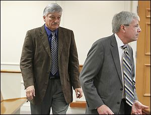 St. John's coach Ed Heintschel, left, appears in Maumee Municipal Court with attorney Richard Hasbrook. A judge rescheduled a pretrial until April 2.