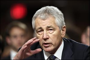 Nebraska Republican Sen. Chuck Hagel, President Obama's choice for defense secretary, testifies before the Senate Armed Services Committee during his confirmation hearing, on Capitol Hill in Washington.