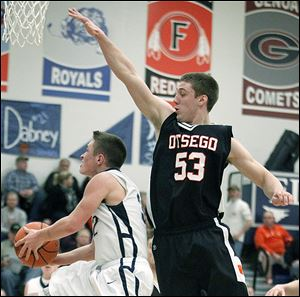 Otsego's  A.C. Limes tries to stop a shot in a game against Lake. Limes set the school record for points in a game (41) this season and is also the career leader with 1,138.