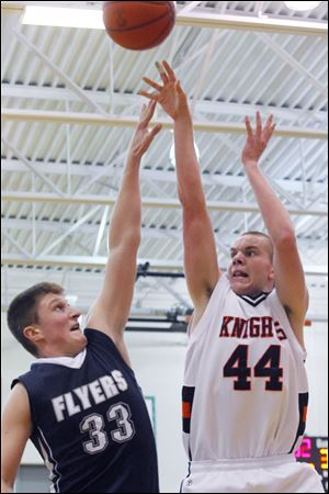 Otsego junior John Thomas shoots over Jayce Vancena. Thomas averages 12.3 points and 6.9 rebounds.