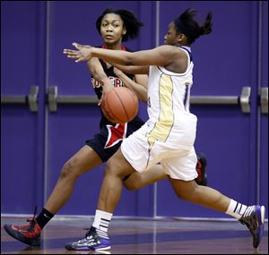 Toriana Easley of Rogers makes a pass against Waite's Ramiah Henry. Easley, a 5-foot-11 junior, averages 9.1 points.