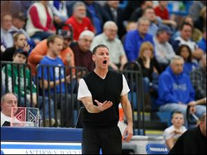 Perrysburg head coach Dave Boyce shouts to his players during a game against Anthony Wayne.