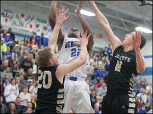 Anthony Wayne's Ose Omofoma (22) goes for two points against Perrysburg's Matt Kaczinski (20) and Bryant Byrd (11).