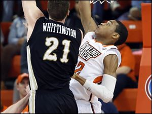 Bowling Green State University forward Richaun Holmes (22) defends against  Western Michigan center Shayne Whittington (21).