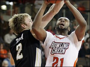 Bowling Green State University guard Chauncey Orr (21) goes to the net against Western Michigan forward Connor Tava (2).