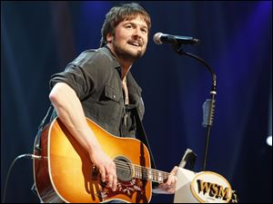 Country singer Eric Church performs leads with seven nominations for American Country Music awards.