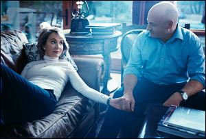 Former Rep. Gabrielle Giffords (D., Ariz.), left, with her husband, former astronaut Mark Kelly, during a Vogue photo shoot at their home in Tucson, Ariz.