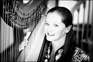 Harpist Julie Buzzelli will be the featured soloist in Harp Madness, Friday at 7 p.m. in Trinity Episcopal Church, 316 Adams St.