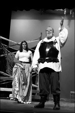 In the Ritz Players' production of  'Man of La Mancha,' Sean Joyce performs in the leading role as Don Quixote. Mandy Bour, portraying Aldonza, looks on.