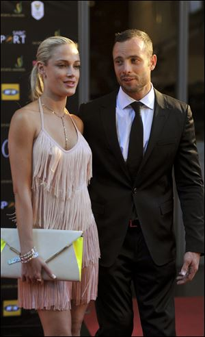 South African Olympic athlete Oscar Pistorius and Reeva Steenkamp, believed to be his girlfriend, at an awards ceremony, in Johannesburg, South Africa.