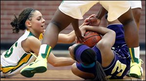 Start's Chelsie Randolph, left, battles Waite's Taylor for a loose ball. The Spartans got back in the game with their pressure defense.
