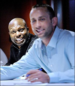 Torii Hunter, left, has been all smiles since signing with the Tigers this offseason.