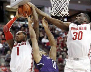 Ohio State's Deshaun Thomas (1) and Evan Ravenel (30) work for a rebound against Northwestern's Reggie Hearn in the second half.