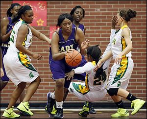 Waite's Latesha Craig knocks over Start's Torie McDuffie. Craig scored 12 points. The Indians will face Rogers in the final.