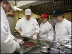 Owens Community College culinary students prepare lunch at the Perrysburg Township school's Terrace View Cafe. Ohio has reduced aid to higher education, putting more of a burden on students and their families.