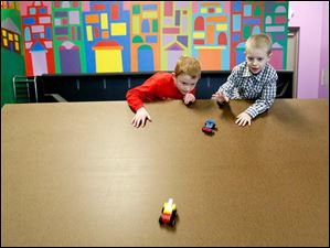 Andrew Boden, 7, left, and Grayson Scheub, 6, chart their Lego cars' progress Thursday afternoon during class at Build It in Perrysburg. Opened on December 26 by Fort Meigs fifth grade teacher Kelisa Boden and her husband Bill, Built It teaches science with Legos and K'Nex.