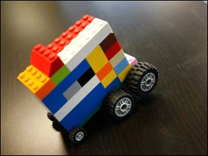 Lucas Fiscus, 9, created a Lego car and named it,