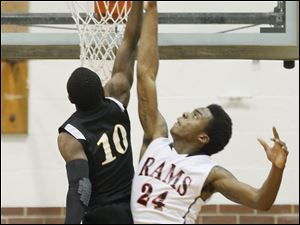 Rogers High School player Tribune Dailey Jr., 24, blocks the shot of Start High School player Dexter Johnson, 10.