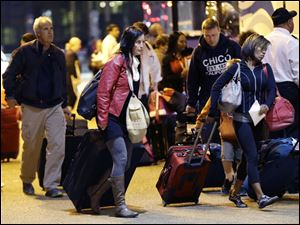 Passengers from the disabled Carnival Triumph cruise ship arrive by bus today at the Hilton Riverside Hotel in New Orleans.