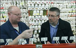 Salesman John Jokinen, left, helps Gordon Cepnick, of West Bloomfield, Mich., select a treble hook for crank baits at Jann's Netcraft. 'Our customers tinker,' Mr. Jokinen says. 'They buy something off the rack, and they're changing it.' Mr. Cepnick started his own lure company last year.
