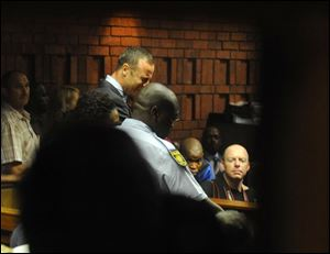 South African athlete Oscar Pistorius reacts,  in court in Pretoria, South Africa, at his bail hearing in the murder case of his girlfriend Reeva Steenkamp.