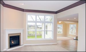 An open floor plan and large windows add to the feeling of spaciousness in the great room.