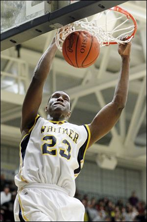 Whitmer's Nigel Hayes (23) dunks the ball against Central Catholic. The senior had 29 points and 13 rebounds for the Panthers in the final home game of his prep career.