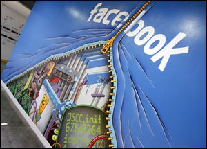 A mural at Facebook headquarters in Menlo Park, Calif. Intruders recently infiltrated the systems running the world's largest online social network but did not steal any sensitive information about its more than 1 billion users, according to a blog posting Friday by the company's security team.