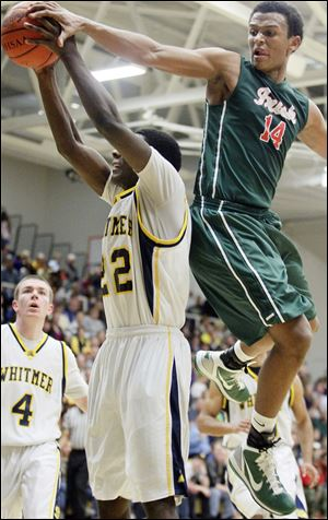 Central Catholic's DeShone Kizer, who had xx points, tries to block a shot by Whitmer's Jon Ashe.