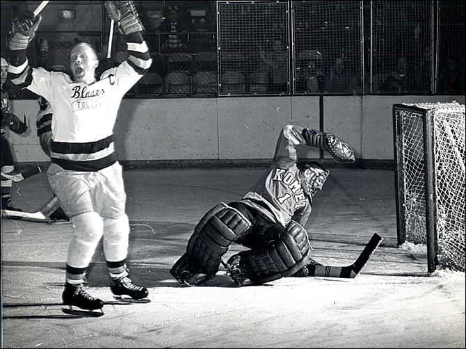 The Blades' Chick Chalmers raises his arms in typical hockey fashion after he scores a playoff goal against Ft. Wayne Komets goalie Chuck Adamson.