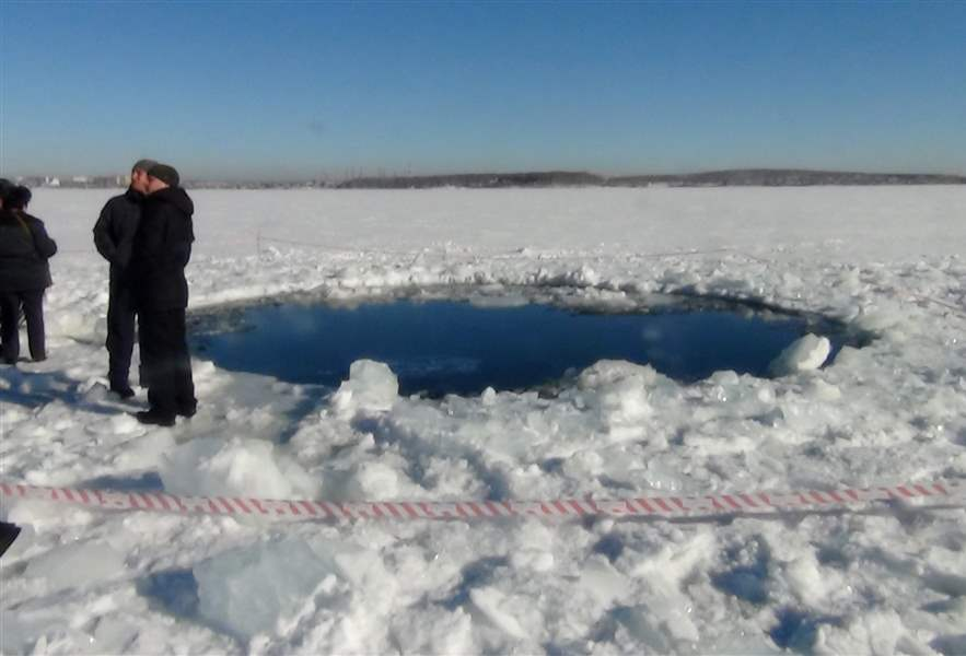 A-circular-hole-in-the-ice-of-Chebarkul-Lake