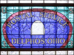 CTY POSTAL17p   A stained glass sign hangs in a window at the Museum of Postal History in Delphos, Thursday, February 13, 2013. The Blade/Andy Morrison
